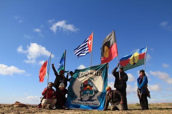 Indigenous Nations flags of West Papua, Australia, Torres Strait, Kanaky and Maluku fly at Lake Eyre