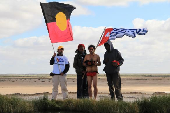 Ceremony collecting the Sacred Water from the Lake Eyre Mound Springs to take as an offering to West Papua