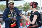 Democracy Now! journalist interviewing the Captain